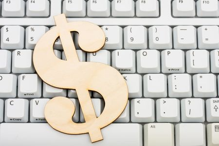 purchased: Dollar symbol on a computer keyboard, spending money online