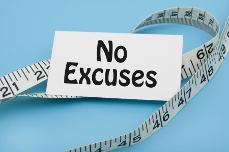 excuse: A white measuring tape with a note saying no excuses on a blue background, measuring  Stock Photo