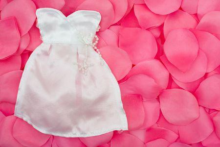 A wedding dress on a flower petal background, wedding dress