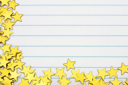 star: Gold stars making a border on a lined paper background, gold star border