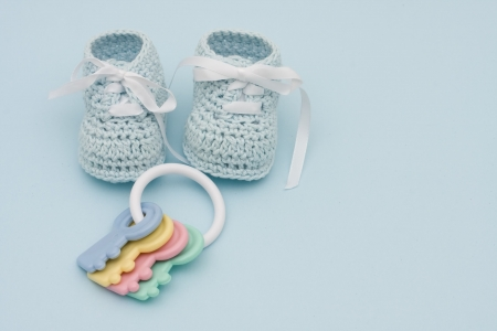 Baby booties on a blue background, baby booties