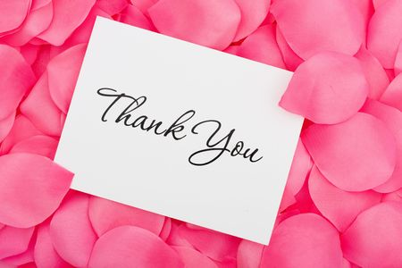 thank you card: A thank you card sitting on a pink flower petal background, thank you with love