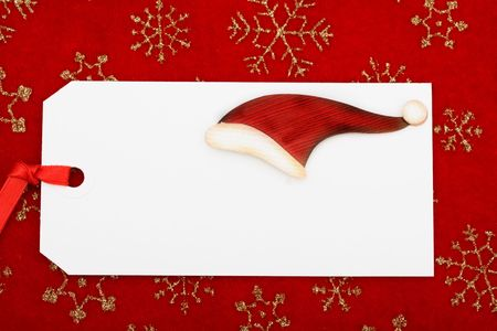 A blank gift tag on a red snowflake background, Christmas gift Stock Photo - 5655133