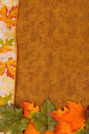 Fall coloured leaves making a border on a brown background, Fall Leaves photo