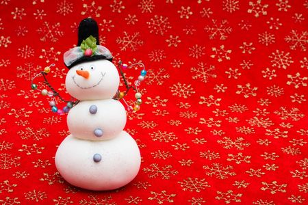 A snowman on a red snowflake background, snowman photo
