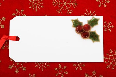 A blank gift tag on a red snowflake background, Christmas gift