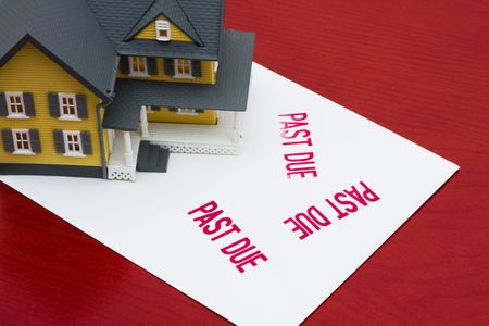 overdue: An overdue bill beside a house on red background, overdue mortgage