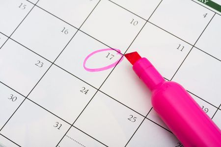 important date: A pink highlighter with a circled day on calendar background, important date Stock Photo