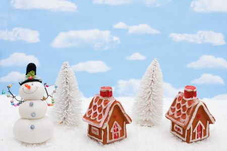 Two gingerbread houses sitting on a snow background, gingerbread houses photo