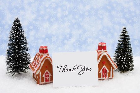 Two gingerbread houses sitting on a snow background, gingerbread houses