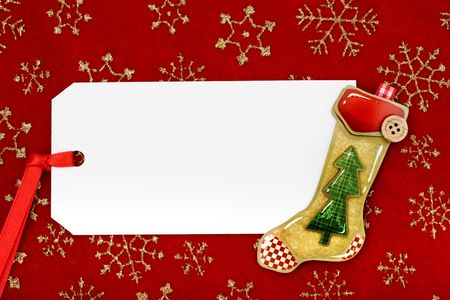 A blank gift tag with a Christmas stocking on a red snowflake background, Christmas gifts photo
