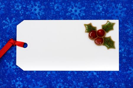 A blank gift tag on a blue snowflake background, Christmas gifts Stock Photo - 5755991