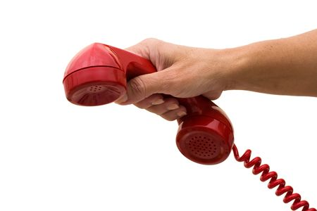 handset: A hand holding a red handset of a telephone isolated on a white background, answering the telephone