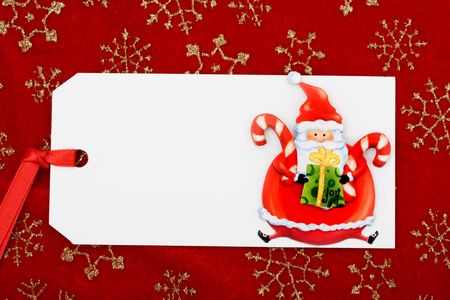 A blank gift tag with Santa Claus on a red snowflake background, Christmas gifts Stock Photo - 5762507