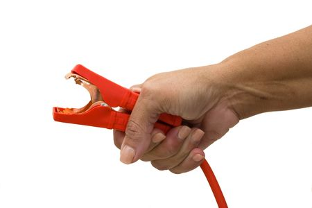 booster: A hand holding a booster cable on a white background, getting a boost Stock Photo