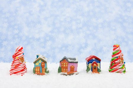 A Christmas village sitting on a blue snowflake background, Christmas village photo