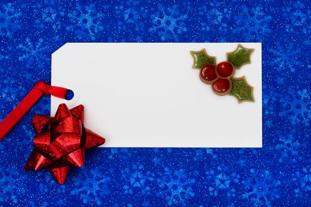 A blank gift tag on a blue snowflake background, Christmas gifts Stock Photo - 5799972