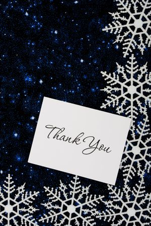 Snowflakes with a thank you card on a blue background, snowflake background Stock fotó