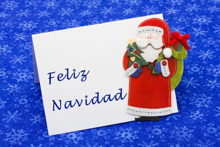 An envelope saying feliz navidad with a Santa Claus on a blue snowflake background, Christmas letter Stock Photo - 5804456