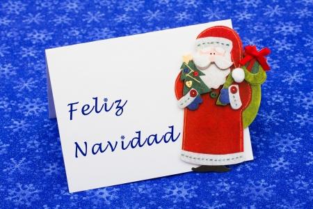 feliz: An envelope saying feliz navidad with a Santa Claus on a blue snowflake background, Christmas letter