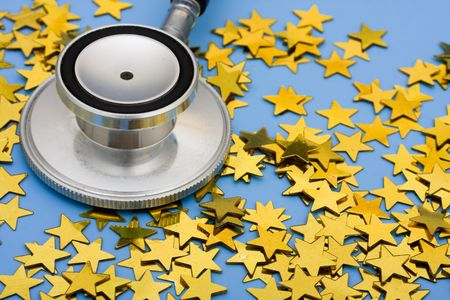A pile of gold stars and stethoscope on a blue background, excellent healthcare Stock Photo - 5804535