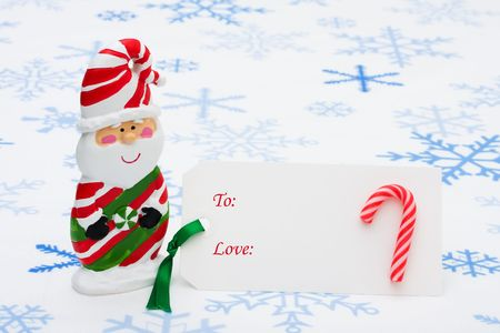 A blank gift tag with a Santa Claus on a snowflake background, happy holidays Stock Photo - 5804540