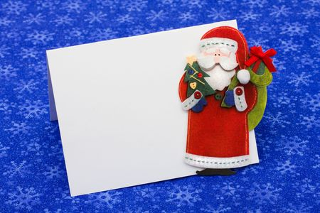 A blank envelope with a Santa Claus on a blue snowflake background, Christmas letter Stock Photo - 5826514