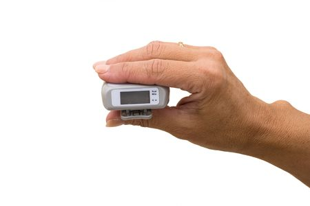 A pedometer in a hand isolated on a white background, counting your steps