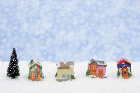 A Christmas village sitting on a blue snowflake background, Christmas village Stock Photo - 5835938