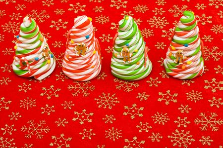 Candy cane Christmas trees on a red snowflake background, Christmas trees Stock Photo - 5835940