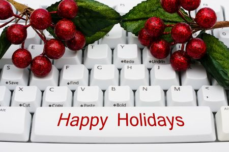 A keyboard with holly and berries, Christmas shopping on the internet photo