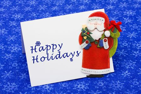 An envelope saying happy holidays with a Santa Claus on a blue snowflake background, Christmas letter Stock Photo - 5835955