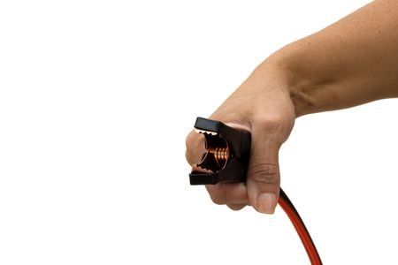 A hand holding a booster cable on a white background, getting a boost photo