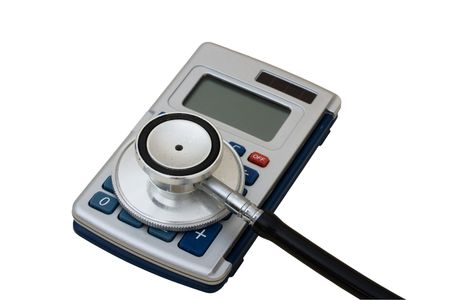 healthcare costs: A calculator and stethoscope isolated on a white background, calculating healthcare costs Stock Photo