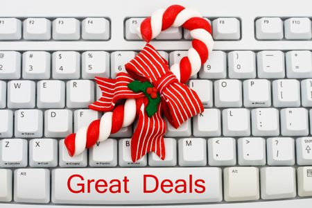 A keyboard saying great deals and a candy cane, Christmas shopping on the internet photo