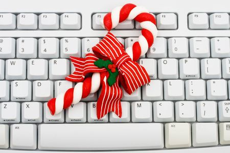 A keyboard  and a candy cane, Christmas shopping on the internet photo