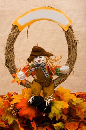 Fall leaves with a scarecrow on a beige background, fall border photo