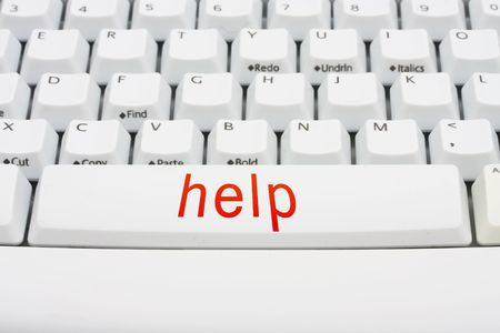 computer help: A keyboard saying help, computer help