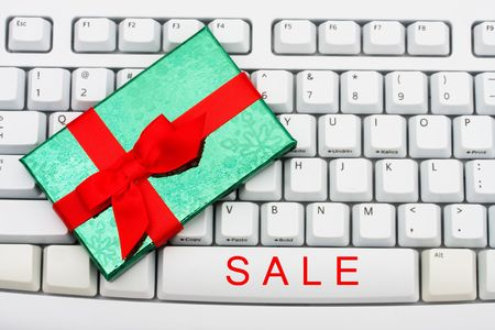 A keyboard saying sale and a present, Christmas shopping on the internet photo