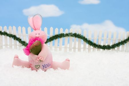picket fence: A pink bunny on a white picket fence with garland on a  sky background, Pink Bunny