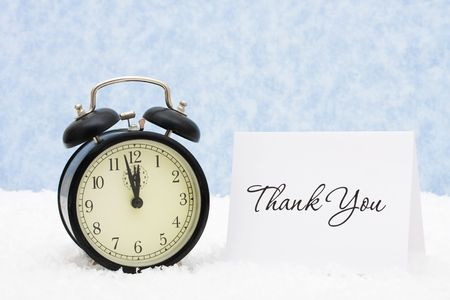 A retro clock with a thank you card snowflake background, thank you photo