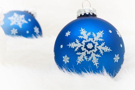blue glass christmas ball ornaments on a white fur background christmas balls stock photo - Glass Christmas Balls