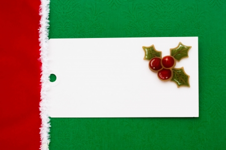 A blank gift tag sitting on a wrapped present, Christmas present photo