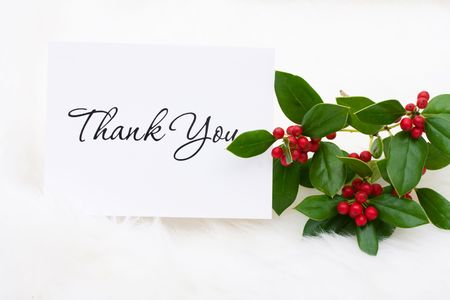 A thank you card with holly and berries on a white fur background, thank you card photo