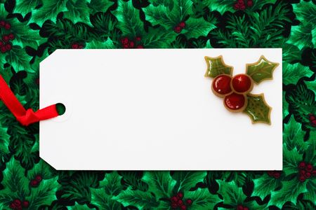 copy space: A blank gift tag sitting on a wrapped present, Christmas present Stock Photo