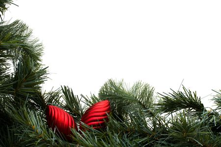 A green garland border with red shiny ornaments isolated on a white background, garland border