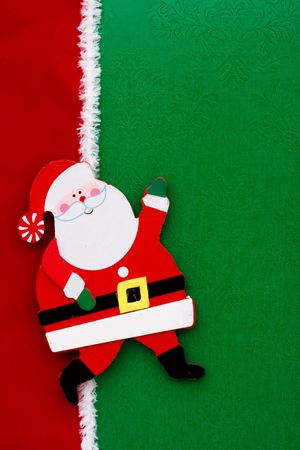 A santa claus on a green background with red ribbon photo