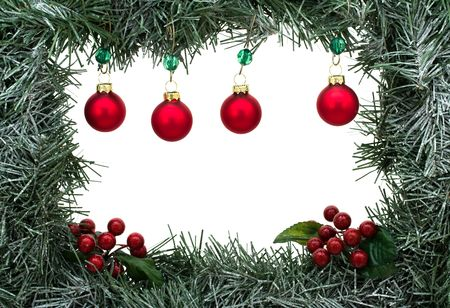 A green garland border with Christmas balls isolated on a white background, garland border