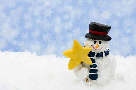 A snowman sitting on snow with a snowflake background, happy holidays photo