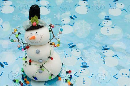 A snowman on a blue snowman background photo